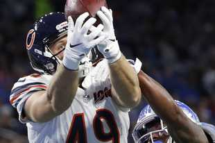 Chicago Bears tight end Jesper Horsted (49), defended by Detroit Lions defensive back Will Harris (25), catches an 18-yard pass for a touchdown during the second half of an NFL football game, Thursday, Nov. 28, 2019, in Detroit. (AP Photo/Rick Osentoski)
