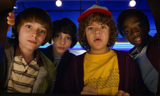 "This image released by Netflix shows Noah Schnapp, from left, Finn Wolfhard, Gaten Matarazzo and Caleb Mclaughlin in a scene from ""Stranger Things."" It took less than a decade for leader Netflix to skyrocket from about 12 million U.S. subscribers at the decade's start to 60 million this year and 158 million worldwide. (Netflix via AP)"