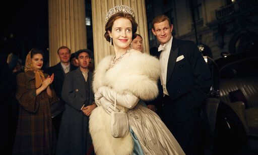 "This image released by Netflix shows Claire Foy, center, and Matt Smith, right, in a scene from ""The Crown."" It took less than a decade for leader Netflix to skyrocket from about 12 million U.S. subscribers at the decade's start to 60 million this year and 158 million worldwide. (Robert Viglasky/Netflix via AP)"