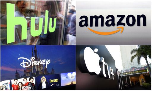 "This combination photo shows, clockwise from top left, the Hulu logo on a window at the Milk Studios space in New York, the Amazon logo in Santa Monica, Calif., the Apple TV+ logo displayed outside the Regency Village Theatre in Los Angeles before the premiere of the the Apple TV+ series ""See,"" and a screen grab of the Disney Plus streaming service on a computer screen."