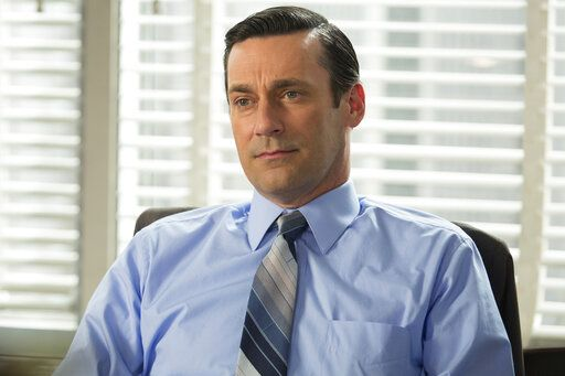 "This image released by AMC shows Jon Hamm as Don Draper in a scene from the final season of ""Mad Men."" AMC took a chance by debuting a '˜60s period piece set in a New York ad agency filled with guys who took three-martini lunches and had trysts with secretaries. It was 'œMad Men'� and its anti-hero was the manly, forever mysterious Don Draper, played by Jon Hamm.  (Justina Mintz/AMC via AP)"