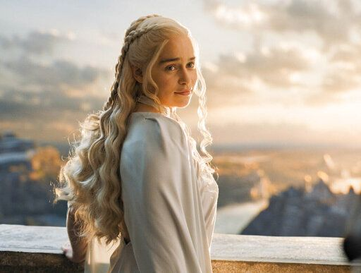 "In this image released by HBO, Emilia Clarke portrays Daenerys Targaryen in a scene from ""Game of Thrones."" In the hands of Emilia Clarke, Dany went from a young girl sold into marriage into a fierce, stately queen. She ruled multiple cities, freed thousands of slaves, build powerful armies and, finally, sat on the Iron Throne, if only briefly. Dany stunned when she hatched three dragons and saved Jon Snow from the Night King's army, prompting many Halloween costumes. But good and evil were often blurred as this fearsome woman went on the march. (HBO via AP)"