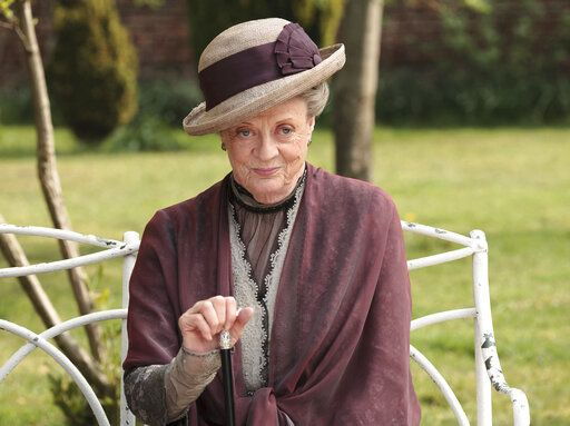 "This image released by PBS shows Maggie Smith as the Dowager Countess Grantham in a scene from the second season on ""Downton Abbey."" The countess was witty, sarcastic and dryly resigned over all six of the show's seasons. She made chilly and imperious somehow hysterical. ""Don't be defeatist dear,'� she once counseled. 'œIt's very middle class."""