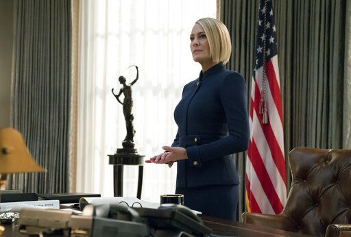 "This image released by Netflix shows Robin Wright in a scene from the final season of ""House of Cards."" Robin Wright's Claire Underwood was always the show's most enigmatic character and when she became president at the end of season five, she said 'œMy turn'� directly to the camera. (David Giesbrecht/Netflix via AP)"