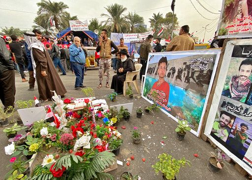 Posters of Anti-government protesters who have been killed in demonstrations are displayed in Tahrir Square during ongoing protests in Baghdad, Iraq, Thursday, Dec. 12, 2019.
