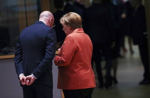 German Chancellor Angela Merkel, right, speaks with European Council President Charles Michel during a round table meeting at an EU summit in Brussels, Thursday, Dec. 12, 2019. European Union leaders gather for their year-end summit and will discuss climate change funding, the departure of the UK from the bloc and their next 7-year budget.