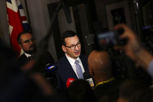 Polish Prime Minister Mateusz Morawiecki speaks with the media at the end of an EU summit in Brussels, Friday, Dec. 13, 2019. European Union leaders gathered for their year-end summit and discussed climate change funding, the departure of the UK from the bloc and their next 7-year budget.