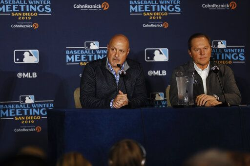 Washington Nationals general manager Mike Rizzo, left, listens to a question alongside agent Scott Boras, right, during the Major League Baseball winter meetings Monday, Dec. 9, 2019, in San Diego. Nationals pitcher and World Series MVP Stephen Strasburg agreed to a record $245 million, seven-year contract on Monday.