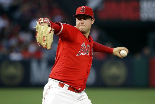 FILE - In this June 29, 2019, file photo, Los Angeles Angels starting pitcher Tyler Skaggs throws to the Oakland Athletics during a baseball game in Anaheim, Calif. Talks to add testing for opioids began following the death of Skaggs, who was found dead in his hotel room in the Dallas area July 1 before the start of a series against the Texas. Major League Baseball will start testing for opioids and cocaine, but only players who do not cooperate with their treatment plans will be subject to discipline, as part of changes announced Thursday, Dec. 12, 2019, to the joint drug agreement between MLB and the players' association.