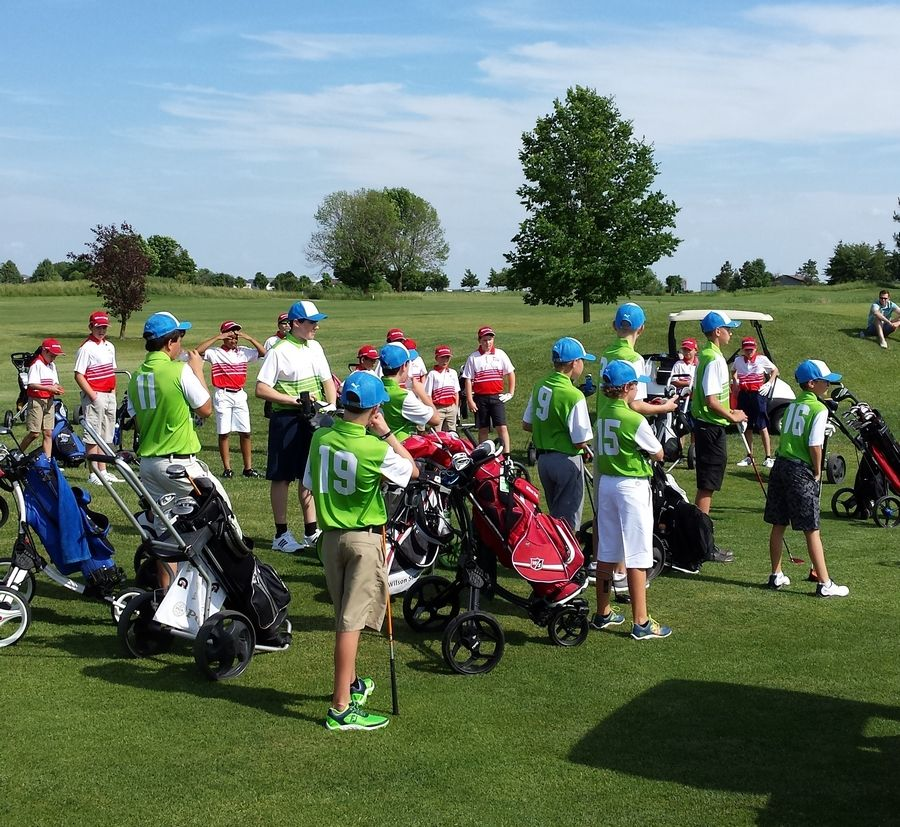 A PGA Junior League team walks to the first tee at Springbrook Golf Course last July.