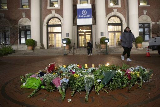 A woman walks past a make-shift memorial for Tessa Majors inside the Barnard College campus, Thursday, Dec. 12, 2019, in New York. Majors, a 18-year-old Barnard College freshman from Virginia, was fatally stabbed in a park near the school's campus in New York City.