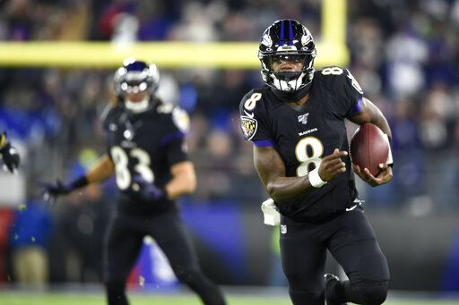 Baltimore Ravens quarterback Lamar Jackson (8) scrambles for yardage against the New York Jets during the first half of an NFL football game, Thursday, Dec. 12, 2019, in Baltimore.