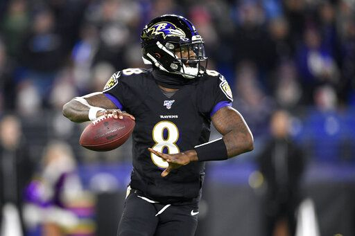 Baltimore Ravens quarterback Lamar Jackson throws a pass against the New York Jets during the first half of an NFL football game, Thursday, Dec. 12, 2019, in Baltimore.