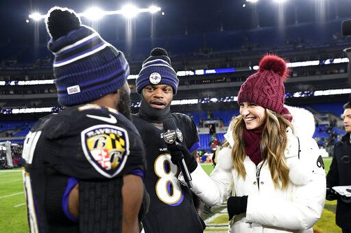 Baltimore Ravens running back Mark Ingram, left, pretends to interview quarterback Lamar Jackson (8) while standing with Fox sideline reporter Erin Andrews after an NFL football game against the New York Jets, Thursday, Dec. 12, 2019, in Baltimore. The Ravens won 42-21.