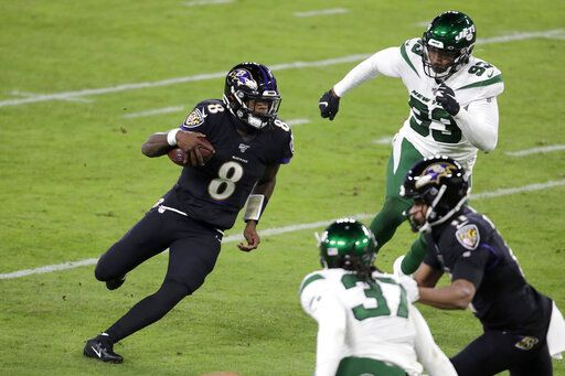 Baltimore Ravens quarterback Lamar Jackson scrambles against the New York Jets during the first half of an NFL football game, Thursday, Dec. 12, 2019, in Baltimore. On the run, Jackson broke the single season record for most rush yards by a quarterback in NFL history.