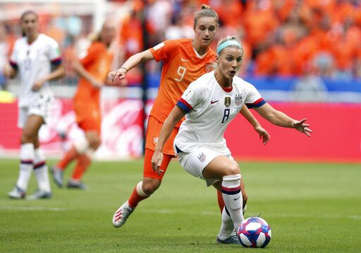 FILE - In this July 7, 2019, file photo, United States' Julie Ertz, right, controls the ball in front of Netherlands' Vivianne Miedema during the Women's World Cup final soccer match at the Stade de Lyon in Decines, outside Lyon, France. Ertz has been named the U.S. Soccer women's Player of the Year on Friday, Dec. 13, 2019, for the second time. Ertz also won the award in 2017 and she won the federation's Young Player of the Year honors in 2012.
