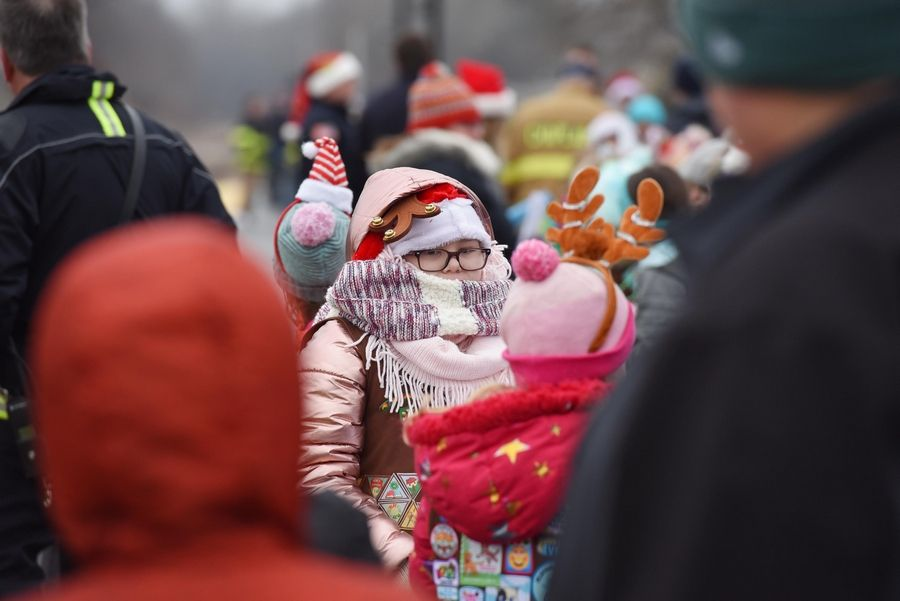 A young girl is bundled against the chill as about 200 people gathered Saturday morning to greet the North Pole Express train at the Pingree Road station in Crystal Lake.