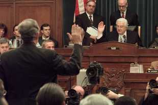 House Judiciary Committee Chairman Henry Hyde of Wood Dale swears in Independent Counsel Kenneth Starr during a November 1998 impeachment hearing on President Bill Clinton's affair with a White House intern.