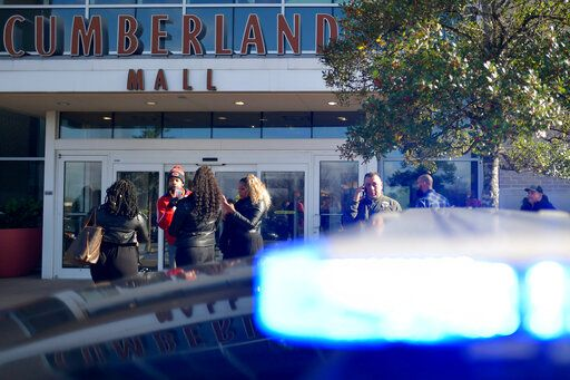 Bystanders wait outside as authorities investigate an incident at Cumberland Mall in Smyrna, Ga., on Saturday, Dec. 14, 2019.