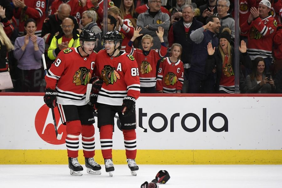 Blackhawks' Patrick Kane, right, celebrates with teammate Jonathan Toews after scoring a hat trick during the third period of an NHL hockey game against the Minnesota Wild, Sunday, Dec. 15, 2019, in Chicago.