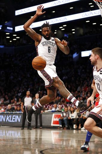 Brooklyn Nets guard Spencer Dinwiddie (8) leaps for the ball during the second quarter of an NBA basketball game against the Philadelphia 76ers at Barclays Center, Sunday, Dec. 15, 2019, in New York.