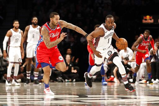 Philadelphia 76ers forward Mike Scott (1) defends against Brooklyn Nets guard Theo Pinson (1) during the first quarter of an NBA basketball game at Barclays Center, Sunday, Dec. 15, 2019, in New York.