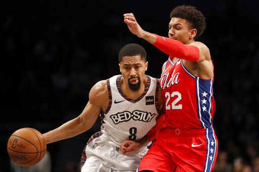 Brooklyn Nets guard Spencer Dinwiddie (8) drives to the basket as Philadelphia 76ers guard Matisse Thybulle (22) defends against him during the second quarter of an NBA basketball game at Barclays Center, Sunday, Dec. 15, 2019, in New York.