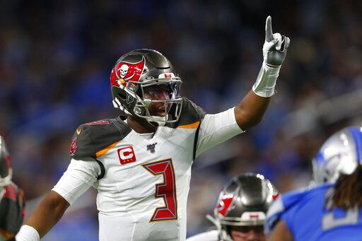 Tampa Bay Buccaneers quarterback Jameis Winston signals during the first half of an NFL football game against the Detroit Lions, Sunday, Dec. 15, 2019, in Detroit.
