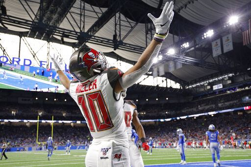 Tampa Bay Buccaneers wide receiver Scott Miller celebrates after his 33-yard reception for a touchdown during the first half of an NFL football game against the Detroit Lions, Sunday, Dec. 15, 2019, in Detroit.