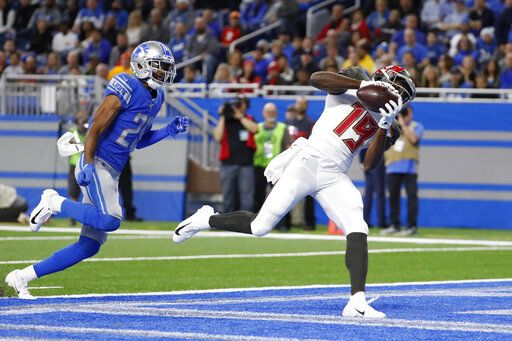 Tampa Bay Buccaneers wide receiver Breshad Perriman (19), defended by Detroit Lions cornerback Rashaan Melvin (29), catches a 34-yard pass for a touchdown during the first half of an NFL football game, Sunday, Dec. 15, 2019, in Detroit.