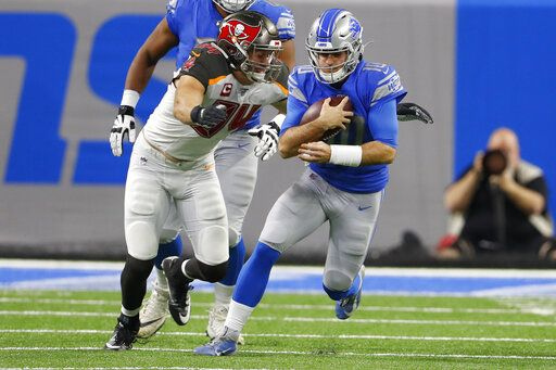 Detroit Lions quarterback David Blough (10) is sacked by Tampa Bay Buccaneers linebacker Carl Nassib (94) during the first half of an NFL football game, Sunday, Dec. 15, 2019, in Detroit.
