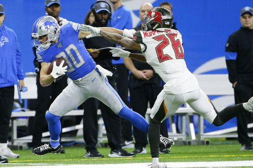 Detroit Lions wide receiver Danny Amendola (80) is pushed out of bounds by Tampa Bay Buccaneers defensive back Sean Murphy-Bunting (26) during the first half of an NFL football game, Sunday, Dec. 15, 2019, in Detroit.