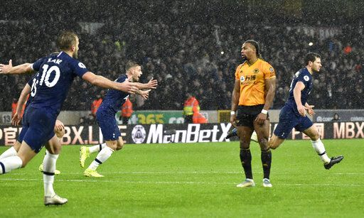 Tottenham's Jan Vertonghen, right, celebrates after scoring his side's second goal during the English Premier League soccer match between Wolverhampton Wanderers and Tottenham Hotspur at the Molineux Stadium in Wolverhampton, England, Sunday, Dec.15, 2019.
