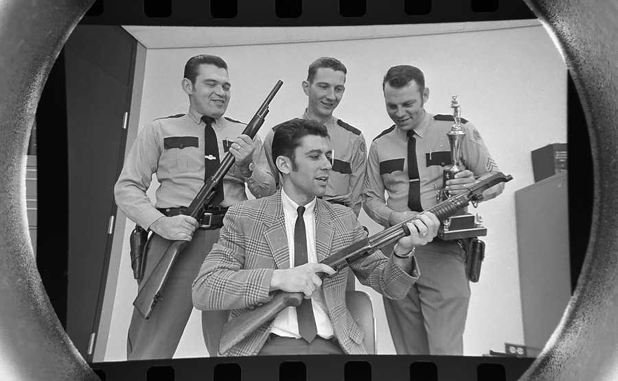 The Daily Herald Archive, Assignment # 15,277, Tom Grieger photo: Wheeling policemen Jack Koenig, Tom Javens, Sgt. Ron Nelson and Clarence Trausch, seated, took first place in the second annual skeet tournament in Northbrook in November of 1969. The group topped 10 other suburban teams at the contest in which policemen shoot skeet with riot shotguns.