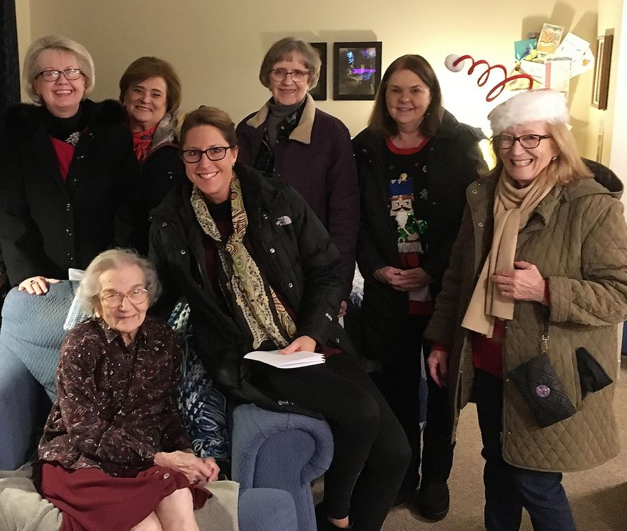 Batavia resident Betty Morehead, seated, enjoys Christmas carols sung to her by, from left, Linda Schielke, Nan Phillips, Polly Clark, Ruth Beck, Marge Brown and Lou Tice.