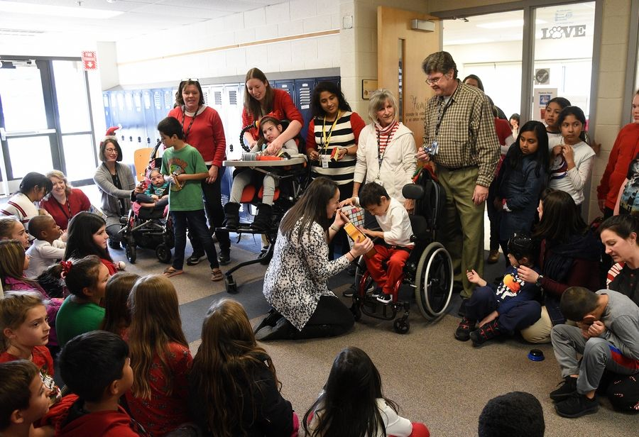 Students in Palatine Township Elementary District 15's adaptive music program sang holiday carols for some of their peers this week at Gray M. Sanborn Elementary School in Palatine.