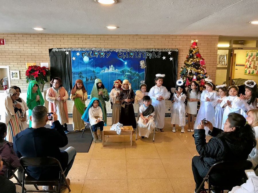 Students took part in a Christmas play Tuesday at St. Colette Catholic School in Rolling Meadows. A decision on the school's possible closure is expected by the Archdiocese of Chicago next month.
