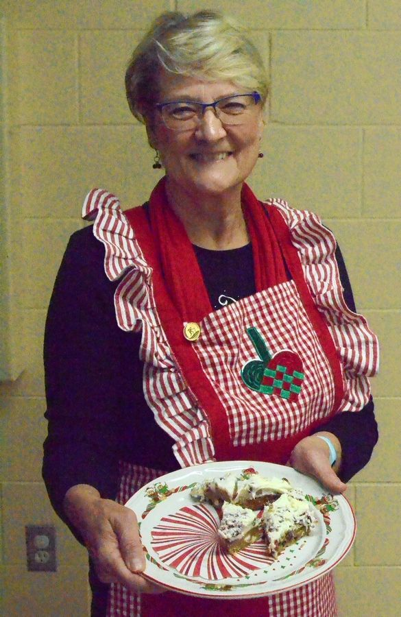 Barb Johnson of Yorkville poses Sunday with her cranberry bliss bars which took first place at Sons of Norway Polar Star Lodge 5-472 bake-off.