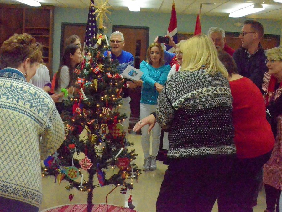 Attendees at Sons of Norway Polar Star Lodge 5-472's Christmas celebration Dec. 8 continue a Norwegian tradition by dancing around a yule tree.