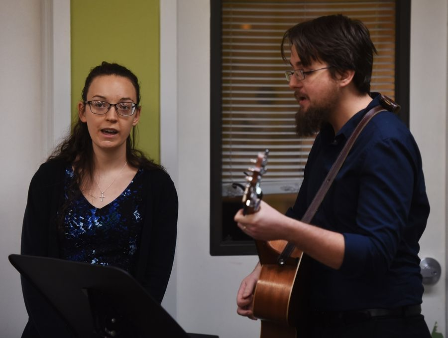 "Carol Marie and Jake O'Marrah of Deerfield sing ""Longest Nights"" at Friday's homeless memorial service organized by JOURNEYS The Road Home in Palatine."