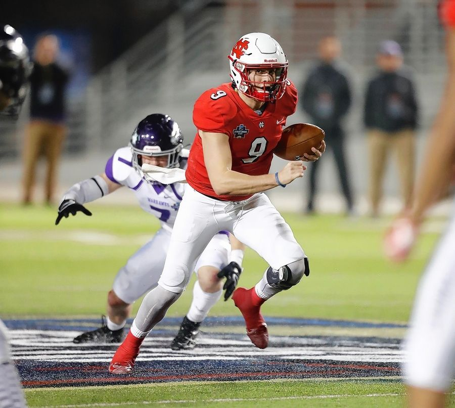 North Central quarterback Broc Rutter scrambles for yards in the Division III national title game Friday night in Shenandoah, Texas. Rutter, a Neuqua Valley alum, threw for 2 touchdowns and ran for another in the Cardinals' 41-14 win over Wisconsin-Whitewater.