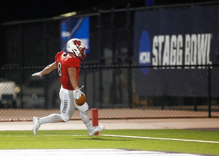 North Central College running back Ethan Greenfield kept scoring touchdowns to help the Cardinals win the NCAA Division III national championship Friday night in Shenandoah, Texas, over Wisconsin-Whitewater.