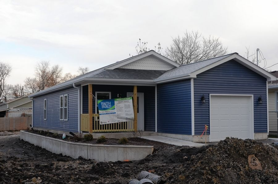 Montgomery-based Fox Valley Habitat for Humanity dedicated its third annual Faith Build home, a partnership of about 20 area faith communities Dec. 7 at 1530 Solfisburg Ave. in Aurora.