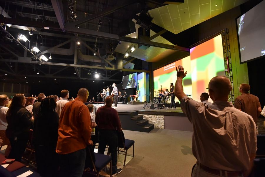 A band plays at the beginning of a service kicking off a new season at Harvest Bible Chapel in Rolling Meadows.