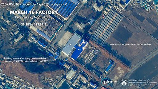 This Dec. 19, 2019, satellite image from Planet Lab Inc., that has been analyzed by experts at the Middlebury Institute of International Studies, shows the March 16 Factory in Pyongsong, near Pyongyang, where North Korea manufactures military trucks used as mobile launchers for long-range missiles. This new satellite image on a North Korean missile-related site shows the construction of a new structure this month. (Planet Labs Inc, Middlebury Institute of International Studies via AP)
