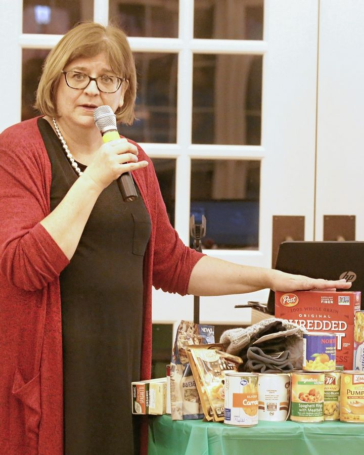Members of the Parables Community, led by Pastor Jeanne Davies, collected food, clothing and other donations Sunday for local organizations.