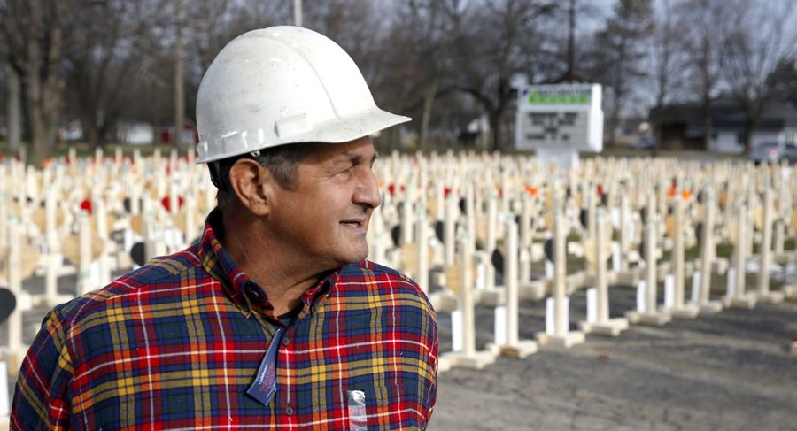 Greg Zanis, of Aurora, stands in front of a display of more than 750 crosses he built to represent each homicide death in 2016 in Chicago. Zanis is retiring from his cross-building mission after 23 years.