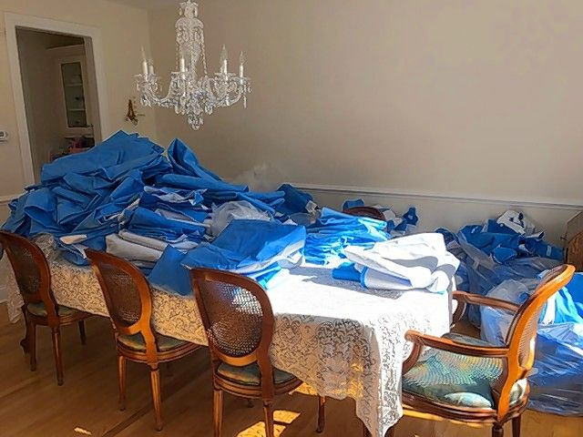 Material that had wrapped surgical instruments trays at Elmhurst Hospital has been sewn into blankets to donate to people who are homeless in a project led by nurse anesthetist Audrey Less. Less collected the material in her parents' dining room in Burr Ridge before her mother and aunt worked to sew it into blankets.