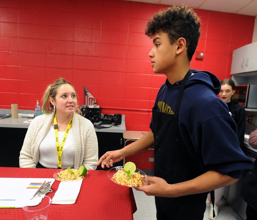 Dennis Diaz, 15, presents a salad that he prepared for the judges in a culinary arts class that's part of the career and technical education program at Barrington High School.