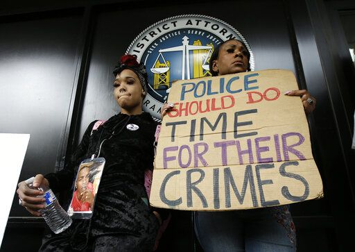 FILE - In this April 4, 2018, file photo, protesters stand outside the office of Sacramento County District Attorney Anne Marie Schubert calling for the indictment of two Sacramento police officers in the shooting death of Stephon Clark, during a rally in Sacramento, Calif. The shooting death of Clark helped spur the passage of two laws to take effect in 2020 giving California one of the nation's most comprehensive approaches to deterring shootings by police. One changes the legal standard for when police can use deadly force, while the companion law increased officers' training on how to handle confrontations.